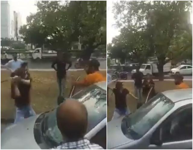 कार टकराने पर लड़की ने बीच सड़क पर रॉड से युवक को जमकर पीटा